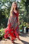 Red summerdress with patterns and made from thin and airy natural cotton.