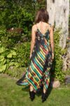The backside of a black summer dress with print in thin multilayered cotton
