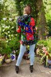 Colorful short jacket with a trendy patchwork pattern, a hood and functional pockets