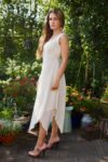Beautiful cream-colored dress in 2 layers- soft natural cotton material and a trendy asymmetrical cut
