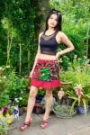 Amazing wrap mini skirt in red with patchwork pattern. One size with pockets and 100 % cotton quality