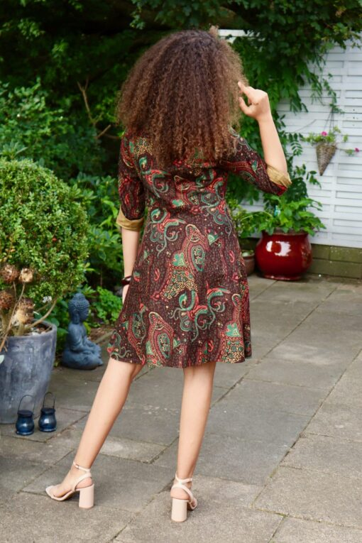 Beautiful everyday dress in brown with ethnic pattern. Midi dress with long sleeves