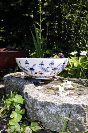Handmade ceramic bowl in white with stunning blue floral motifs