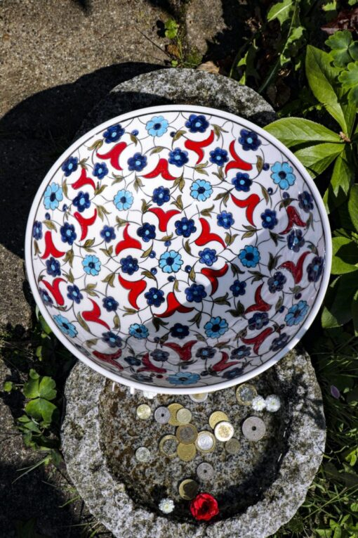 Lead free & handmade ceramic bowl with gorgeous blue and red colored floral decorations.