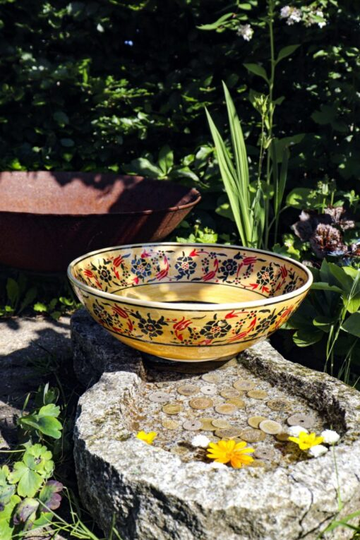 Exclusive colorful ceramic bowl in yellow with adorable floral motifs. Handmade food-safe quality