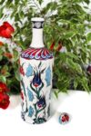 Ceramic bottle with floral motifs in blue, red and turquoise colors. Foodsafe quality and perfect for kitchen oils.