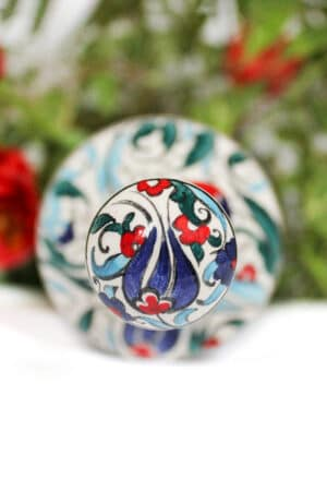 Handpainted ceramic lid with a blue tulip motif. For a handmade ceramic oil bottle with flowers