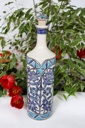 Handmade blue ceramic bottle with floral motifs and handpainted lid. Foodsafe and suited for oils