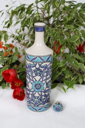 Ceramic bottle with blue turquoise floral motifs. Handmade, lead and cadmium free, ideal for  oils. A perfect gift idea.