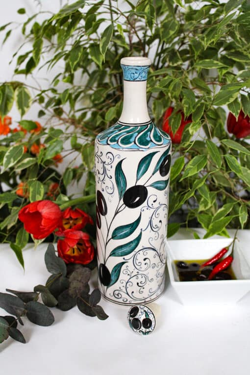Decorative handmade bottle in ceramics. Colorful olive motifs, toxin free and ideal for salad oils. Perfect gift idea.