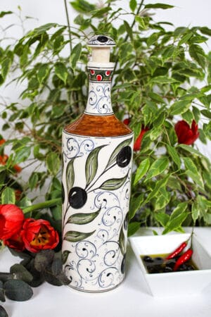 Elegant handmade olive oil bottle in beautiful ceramics. Decorated with olive branches in black, green and golden colors.