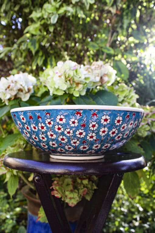 Handmade colorful ceramic bowl with the tree of life in blue, turquise, red and white colors
