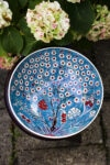 Handmade turkish bowl showing the tree of life in bright colors