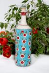 Handmade bottle with flowers in red and white on a turquoise background. Handpainted lid