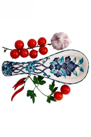 Trendy and functional spoon holder for keeping your counter clean. Handmade sturdy ceramics with a blue/ turquoise floral motif. Leadfree
