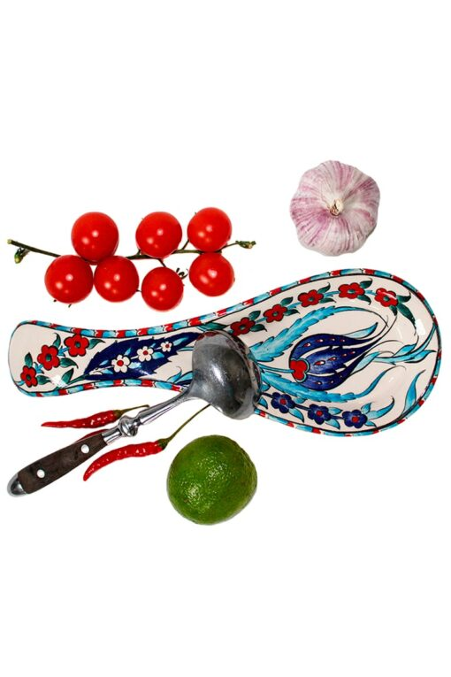 Functional spoon rest in colorful leadfree ceramics. Handmade and decorated with blue, red and turquoise floral motifs