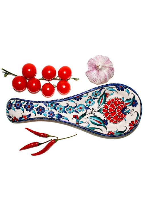 Smart for cooking. Practical and stylish spoon holder with floral motifs in blue, red white and turquoise colors. Leadfree