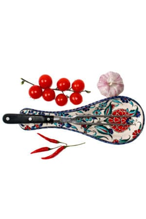 Leadfree handmade spoon rest in ceramics. Sturdy elegant design with floral motifs on a white backdrop