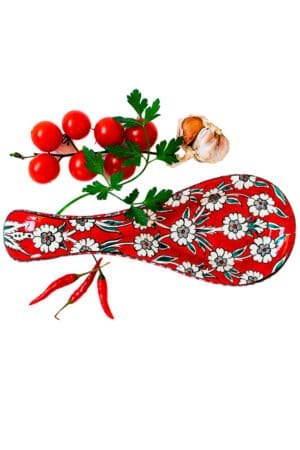 Ceramic spoon rest in a hot red color with love floral motifs. Perfect for resting your kitchen gear while cooking keeping the counter clean. Foodsafe