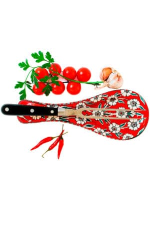 Handmade ceramic spoon rest in warm red with delicate white flowers. For cutlery, food safe and dishwasherproof.