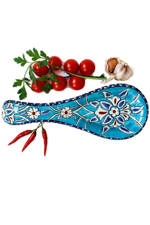 Colorful turquoise spoon holder in handmade Turkish ceramics, decorated with white, red and blue floral motifs. Leadfree quality