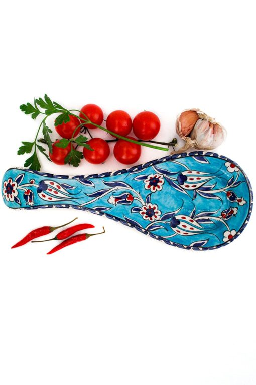 Decorative spoon rest in handmade leadfree ceramics. Turquoise with tulip motifs. Dishwasherproof