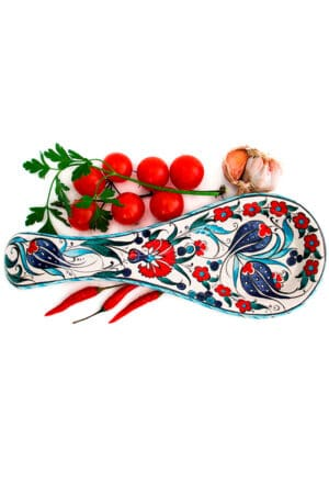 Handmade lead free spoon rest in sturdy ceramics decorated with colorful tulips and carnations. Dishwasherproof