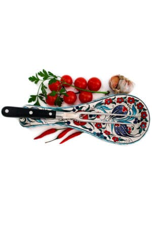 Colorful ceramic spoon rest ideal for holding your kitchen gear while cooking. Leadfree ceramics with floral motifs and dishwasher safe