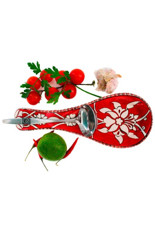 Practical spoon holder in leadfree ceramics suited for resting your spoon while cooking. Red color with white flowers