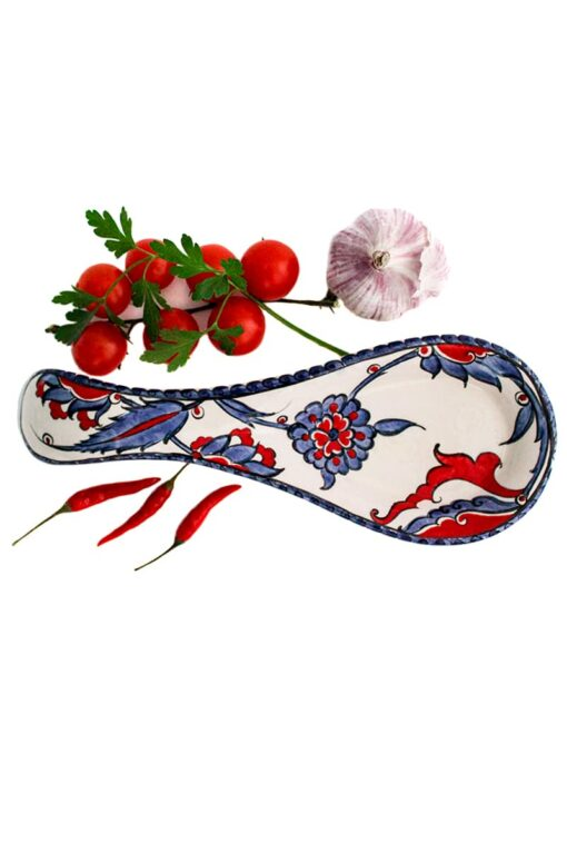 Spoon holder in handmade sturdy ceramics perfect for resting your kitchen cutlery while cooking. Colorful floral design in blue, red, white and purple