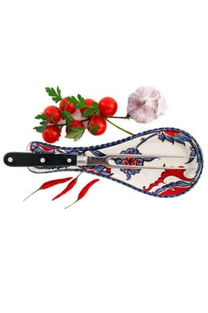 Decorative ceramic spoon rest with blue,purple and red floral motifs on a white backdrop. Leadfree