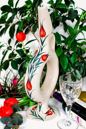 Handmade wine decanter with a Hittite circle shape. Decorated with red tulips