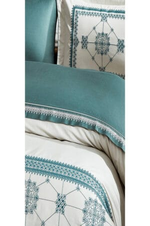 Embroidery and motifs in details. Dusty green/blue colors on a creme background. Luxury bedlinen - double duvet