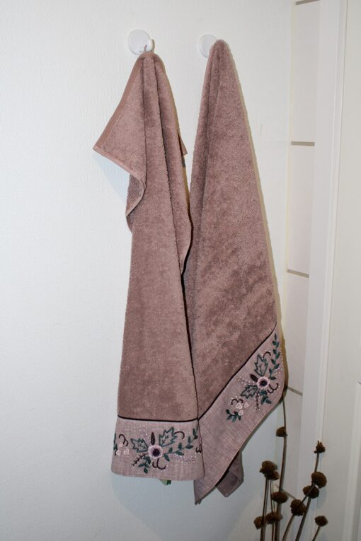 Organic towel set with a handmade embroidery at the bottom. Dusty rose color