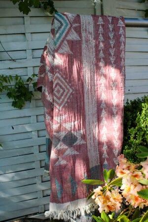 Organic flat woven towel, hammam style. Red colored jacquard pattern. 100% cotton