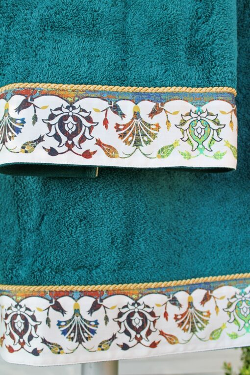 Printed border ornamenting an exclusive towel set with gorgeous floral motifs in various dusty colors