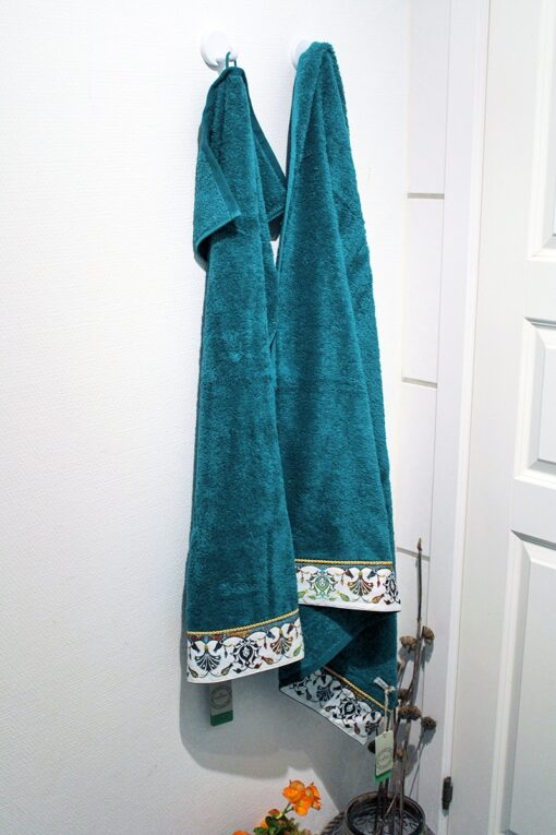 petrol colored soft organic towel set with detailed print at the bottom