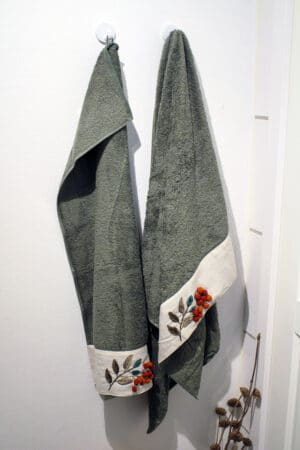 dusty green unique towel set with beautiful nature-colored embroideries