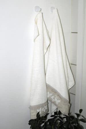Elegant white and beige towel set with beautiful decorative details