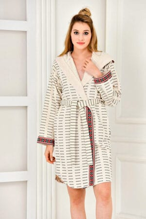Trendy patterned bathrobe with a hood and borders in an ethnic style