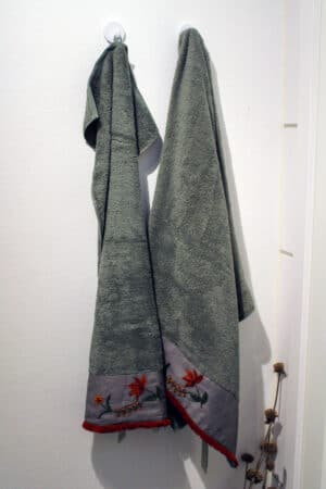 Green towelset with handmade red embroideries