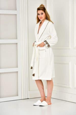 Super soft white bathrobe with goldenbrown motifs